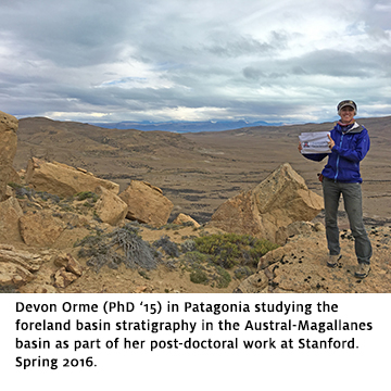 Alumna Devon Orme holds a UA Geosciences flag in Patagonia, Argentina.