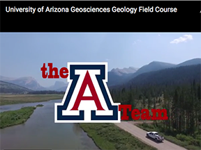 "A still from the field camp video shows a river, mountains and the UA ""A""."