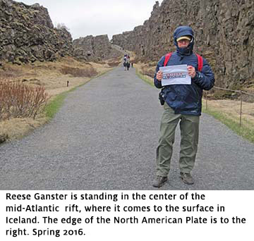 Geoscientist Reese Ganster holds UA Geosciences flag on a walking trail in Iceland