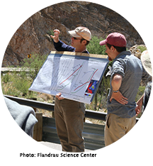 Professor Jon Pelletier holds a diagram and talks to a group on Mt. Lemmon