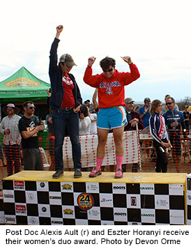 Two women stand on the winners' podium