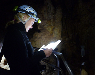 Student working in a cave