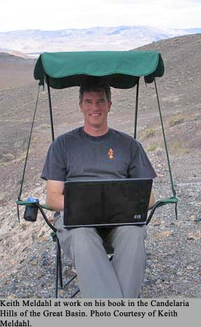 Keith Meldahl sitting in a chair with a laptop in the Great Basin