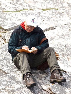 George Davis taking notes on an outcrop